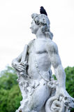Ancient Roman sculpture with bird on head Royalty Free Stock Photos
