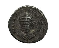 Ancient roman silver coin with female portrait isolated on white. Macro shot stock photos