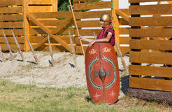 Ancient Roman Soldier Guarding the Encampment. AQUILEIA, Italy - June 18, 2017 : Ancient Roman soldier guarding the entrance of a military encampment at the Stock Photography