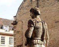 Ancient Roman soldier sculpture in Bath, UK. Ancient Roman soldier sculpture in historical site of Roman Bath, UK Royalty Free Stock Images