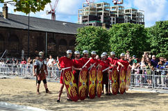 Ancient Roman soldiers. London, Granary Square  - August 31, 2014: during the Battle Bridge event at King's Cross, Roman soldiers face Boudicca Stock Photo
