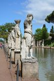 Ancient roman statues at the edge of a pond in Tivoli, Italy royalty free stock image