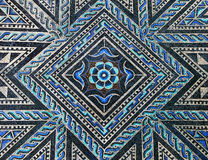 Ancient roman stone mosaic floor. Beautiful ancient roman stone mosaic floor with geometric and floral blue and black design stock image