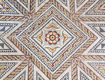 Ancient roman stone mosaic floor with geometric design. Ancient roman stone mosaic floor with geometric and floral design royalty free stock photography