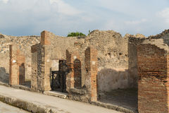 Ancient Roman Street. Pompeii was an ancient Roman town-city near modern Naples, in the Campania region of Italy, in the territory of the comune of Pompei Royalty Free Stock Photos