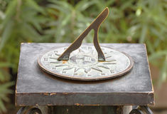 Ancient roman sundial in garden Royalty Free Stock Image