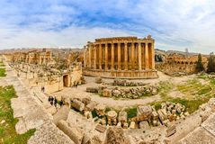 Ancient Roman temple of Bacchus panorama with surrounding ruins of ancient city, Bekaa Valley, Baalbek, Lebanon. Dionysus antique archaeological archeology royalty free stock image