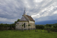 Ancient romanian church. With dramatic sky in background Stock Image