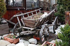 Ancient romanian wooden cart standing on snow Royalty Free Stock Images