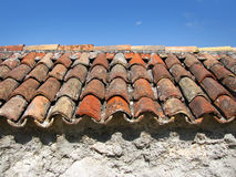 Ancient roof tiles. On old weathered house Stock Photos