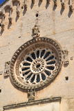 Ancient rose window. Exterior of the rose window (or Catherine window) of an ancient church Royalty Free Stock Photo