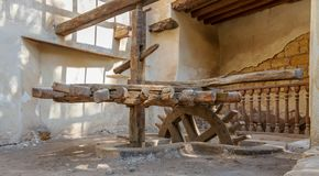 Ancient rotary Flour Mill used to be rotated by animal power in front of El Sehemy historic house, Cairo, Egypt stock image