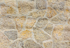 Ancient roughness stone wall. Stonework of sandstone.. Royalty Free Stock Photos