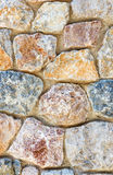 Ancient roughness stone wall.  Stonework of sandstone. Multicolor texture. Royalty Free Stock Photography