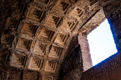 Ancient round cassette ceiling with natural sunlight penetrating through the window. Aperture royalty free stock photography