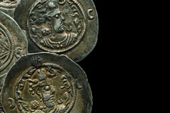 Ancient round silver coins isolated on black Royalty Free Stock Photography
