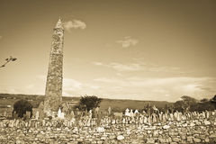 Ancient round tower and celtic graveyard in sepia Royalty Free Stock Images