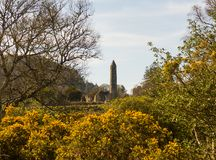 The ancient round tower in the cemetery at the historic Glendalough Monastic Site in County Wicklow in Ireland Stock Photography