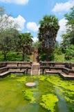 Ancient royal bathing pool. Ruins of  Kumara Pokuna (royal bathing pond) in ancient Sri Lanka capital Polonnaruwa under blue sly Royalty Free Stock Images