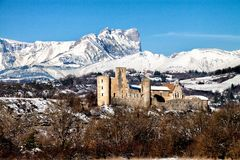 Ancient Ruin in France in the snow near Aix en Provence. Stone ruin in France near Aix en Provence with a snowy mountain backdrop Stock Photography