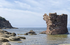 Ancient ruin of tower emerges from sea Royalty Free Stock Photography