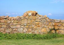 Ancient ruin wall of rocks with blue sky Royalty Free Stock Photo