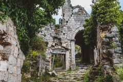 Ancient Ruined Arc and Ivy Wall in Stari Bar. Ancient stone ruins and ivy temple wall archway at Old Bar town on Montenegro. Stari Bar - ruined medieval city on Stock Photography