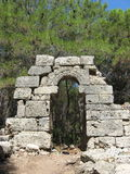 Ancient ruined arch in Phaselis Royalty Free Stock Photography