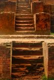 Ancient ruined building staircase of near Dhaka, Bangladesh. Made of old bricks, lime and clay stock photography
