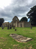 Ancient Ruined Derelict Scottish Church and Graveyard. Very old church in Scotland that`s largely derelict and has a large graveyard. The picture was taken on an Stock Images