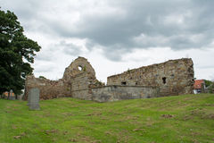 Ancient Ruined Derelict Scottish Church. Very old church in Scotland that`s largely derelict and has a large graveyard. The picture was taken on an overcast and Stock Photography