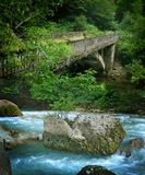 Ancient ruined stone bridge across a mountain river. In the Caucasus Royalty Free Stock Photography