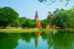 An ancient ruined temple near the lake. Ayutthaya Thailand. Royalty Free Stock Photos