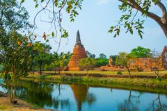 An ancient ruined temple near the lake. Ayutthaya Thailand. Stock Photography