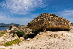 Ancient Ruines of Nora near Pula in Sardinia. Ancient stone ruins of Nora in Sardegna, Italy. Brick, stone and sand under blue sky. Archeological place Nora in royalty free stock images