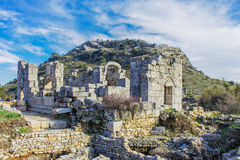 Ancient ruines. Ruines in Turkey near historic rock-cut tombs Royalty Free Stock Images