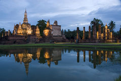 Ancient ruins. Buddha statue and ancient ruins of temple in Sukhothai,Thailand Royalty Free Stock Images
