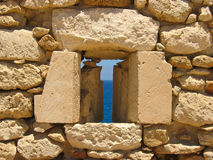 Ancient Ruins. Ancient ruined fort window on the Mediterranean and blue sky Stock Photography