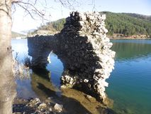 Ancient ruins. Ancient building ruins by a lake stock images