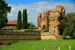 Ancient ruins. On the background of modern buildings in the city Royalty Free Stock Photos
