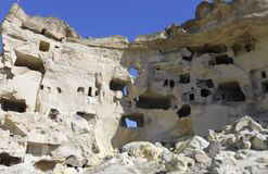 Ancient ruins, stone caves. Ancient ruins, in Cappadocia, in Central Anatolia Royalty Free Stock Image