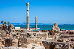 Ancient ruins at Carthage, Tunisia with the Mediterranean Sea in Royalty Free Stock Photos