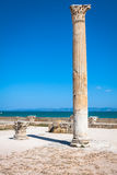 Ancient ruins at Carthage, Tunisia with the Mediterranean Sea in Stock Images