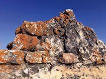 Ancient ruins at Castillo Las Aguzaderas, Andalusia, Spain. Featuring crumbing masonry and litchen Stock Photo