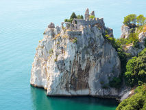 Ancient ruins of castle on cliff stock photo