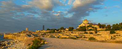 Ancient ruins Chersonesus Taurica in the rays of setting sun. Stock Photos