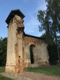 Ancient ruins in the city park. The remains of the building are made of red brick Royalty Free Stock Photo