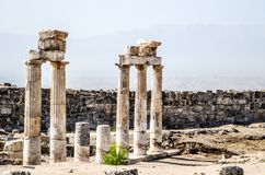Ancient ruins of columns in the ancient city of Hierapolis in Pamukkale, Turkey. Ancient ruins of columns in the ancient city of Hierapolis in Pamukkale stock image
