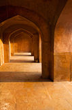 Ancient ruins: corridor with arches Stock Photos
