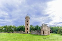 Ancient Ruins of Eglinton Castle and a blue cloudy sky in Irvine Scotland. Eglinton castle Ruins taken on a cloudy day before it rained. Surrounded by trees it Royalty Free Stock Photo